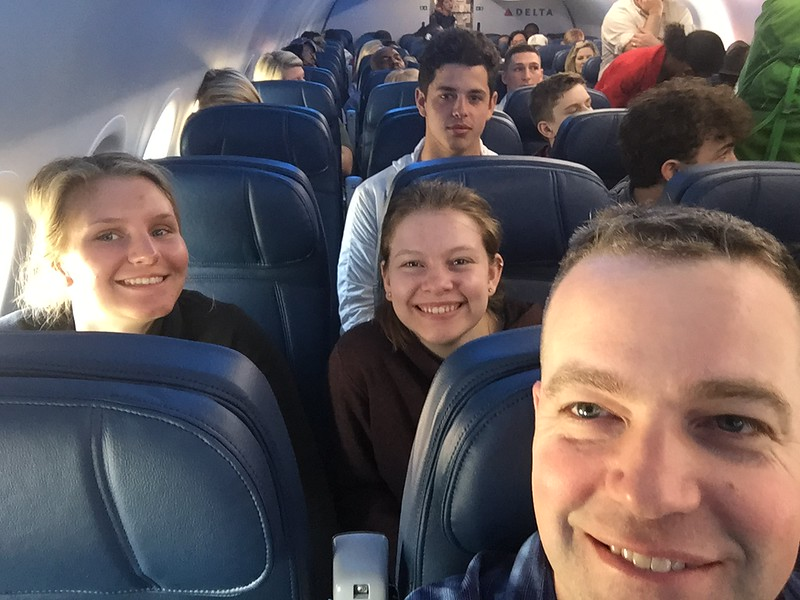 DAY 1<br /> Leaving Atlanta for Haiti. Me, Hailey & Lexi (You're welcome Lexi for taking my seat) & some random traveler who gave a half smile.