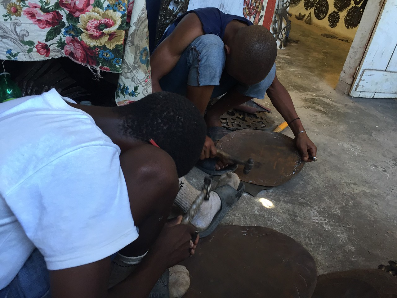 Day 8<br /> Kids hard at work in the metal village.
