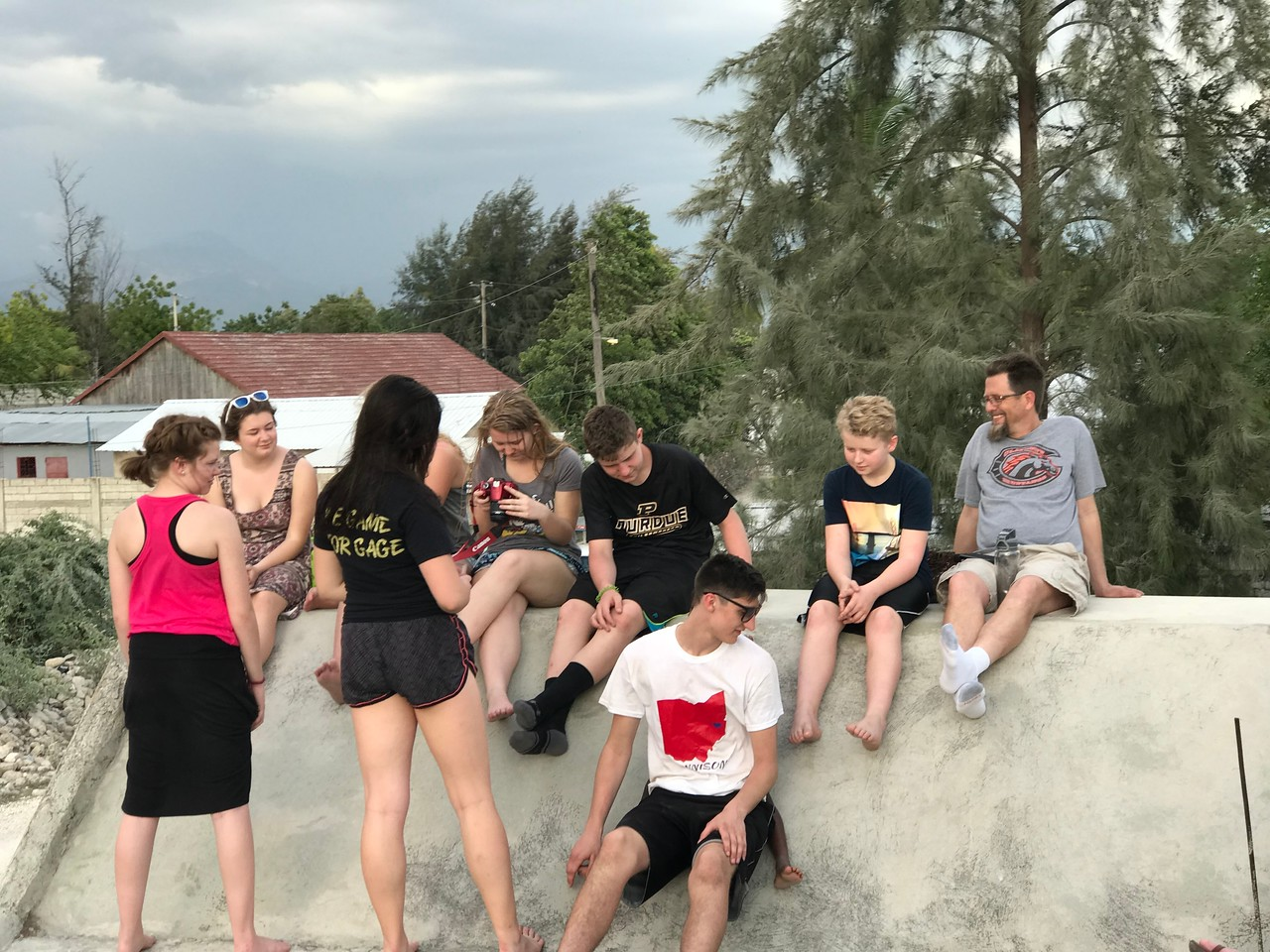 DAY 3<br /> Our kids hanging out with Ron on the roof of the team house.<br /> <br /> *Photo credit: Ryan Hicks