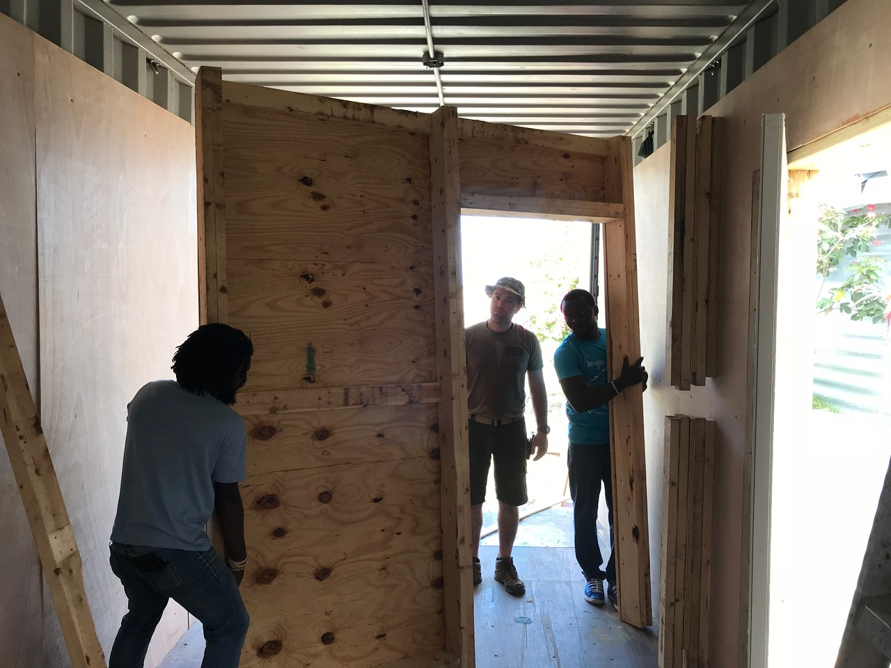 DAY 6<br /> Installing the repurposed partition wall.<br /> <br /> *Photo credit: Ryan Hicks