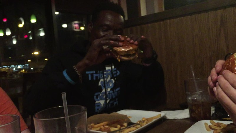 "DAY 10<br /> * Video-click to play*<br /> Dinner with the team at TGI Friday's at the airport.<br /> Pascal enjoying a cheeseburger ""with everything on it, yes, please."""