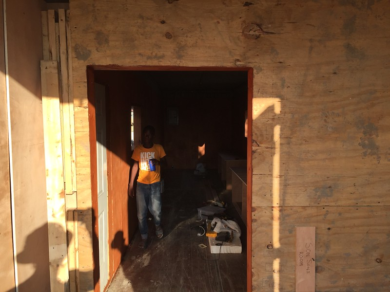 DAY 6<br /> Looking through the rear cargo doors and through the partition wall into the classroom.