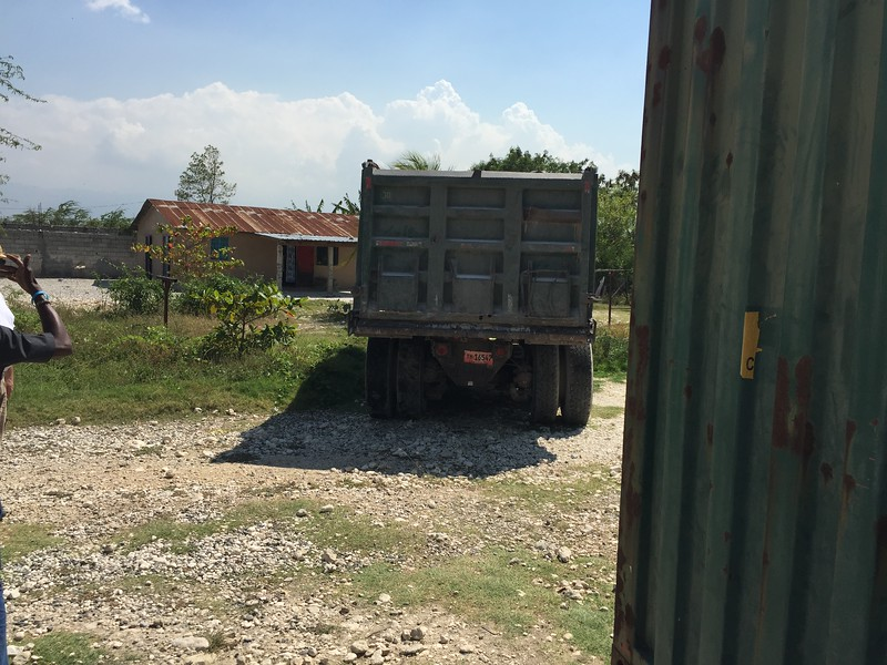 DAY 4<br /> Pascal had arranged for a guy in an old beat up dump truck to stop by the orphanage to shove the container into it's final place.<br /> This would prove to not be an easy task.... in Haiti