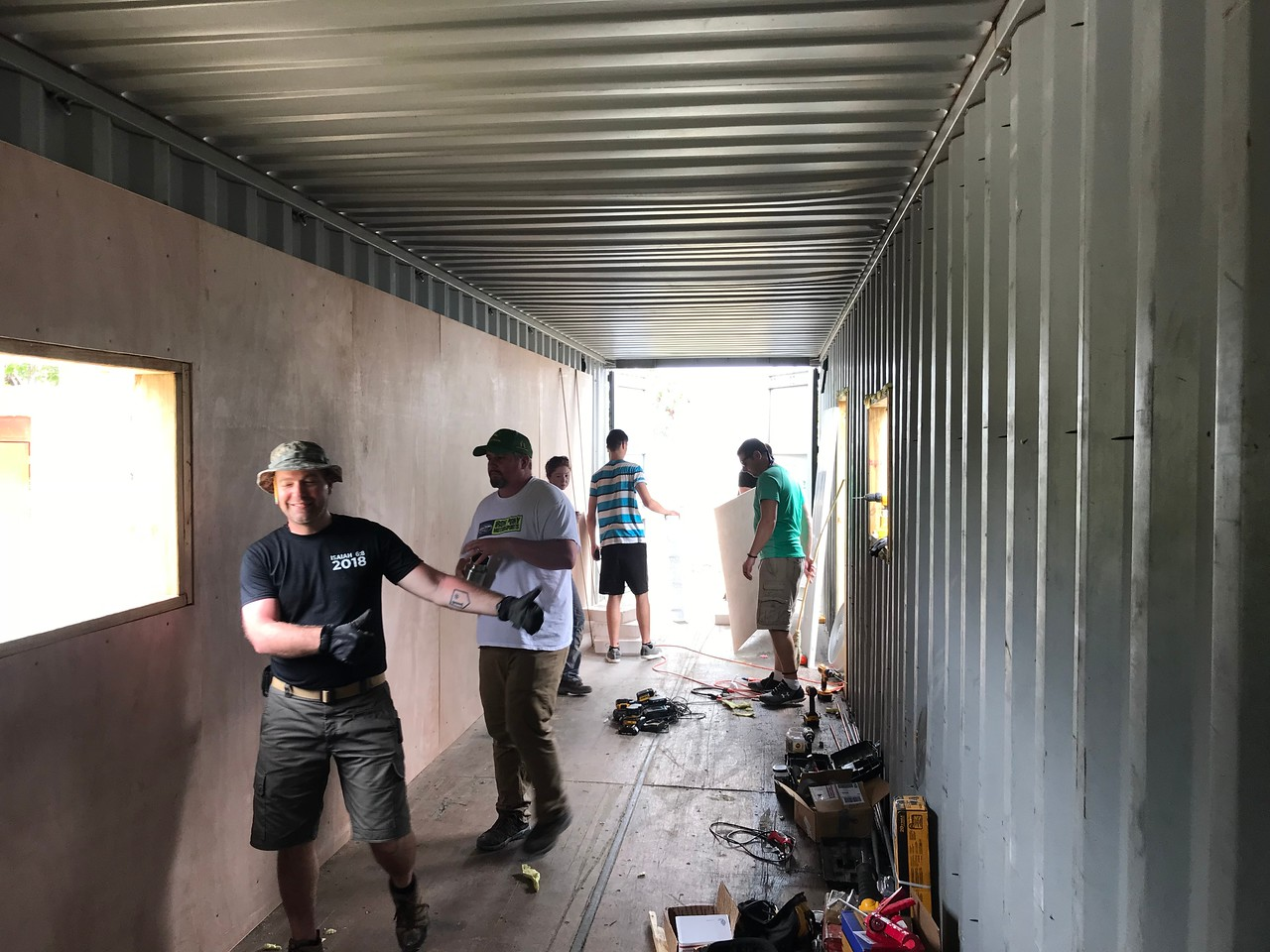 DAY 5<br /> Installing the plywood walls. <br /> <br /> *Photo credit: Ryan Hicks