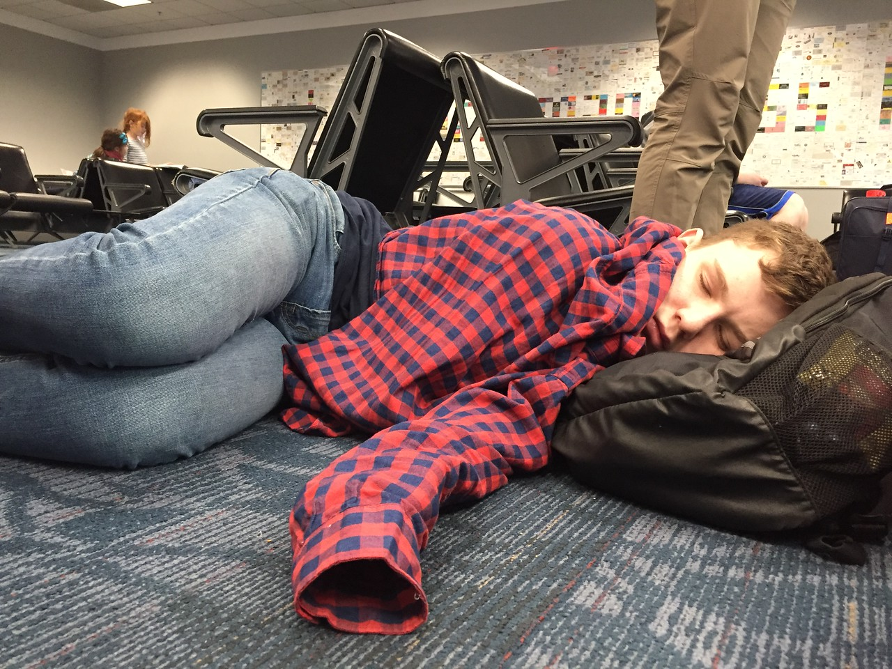 DAY 1<br /> Ceremonious picture of Sam Caley asleep on an airport floor.<br /> (Look at my other two mission trip galleries, you'll see what I mean)