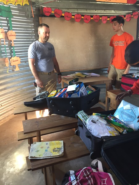 DAY 9<br /> Monday at school.<br /> Hailey, Lexi, Derrick and I worked with Berline to hand out school supplies to the first grade class.