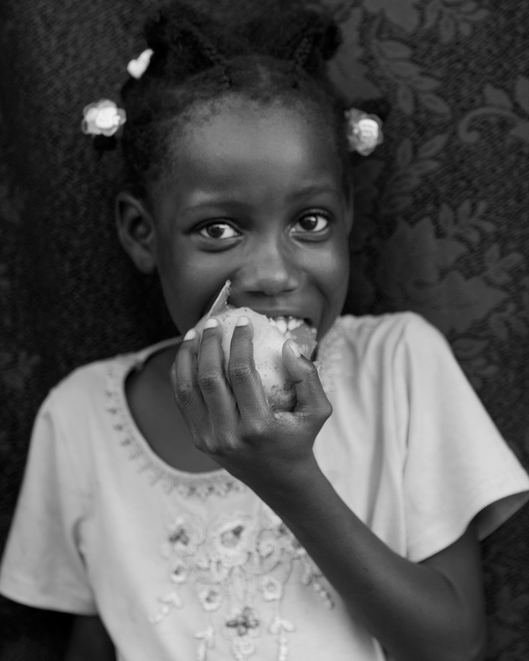 Haitan Girl eating Mango.
