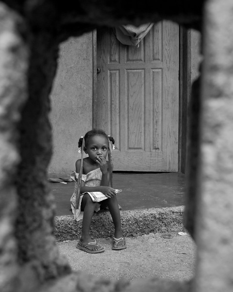 girl through a hole in the fence...this was from a main how looking thru to servants quarters.