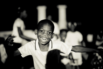 A young boy poses for the camera at night. Carrefour, Haiti