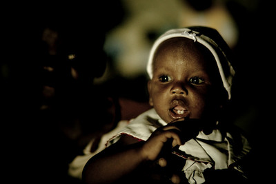 Young child at night. Carrefour, Haiti