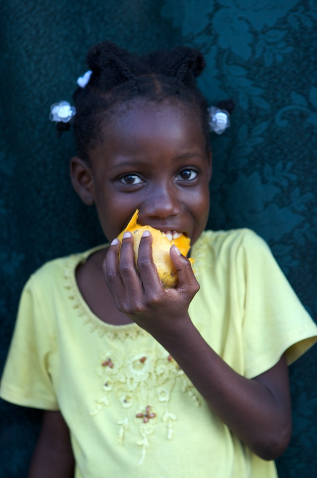 Haitan Girl eating Mango