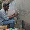 Artist painting on canvas-Port au Prince-Haiti
