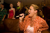 Doing what she loves best dispite the line of kids waiting behind her to get their chance on the microphone - Cindy and her Karaoke