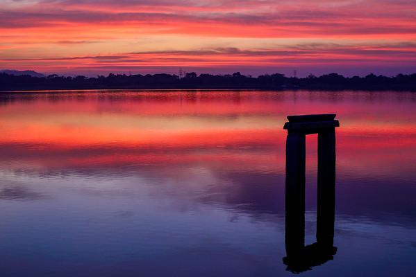 Gorgeous sunset over the Kannada University lake in Hampi