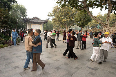 Seniors dancing in the park.