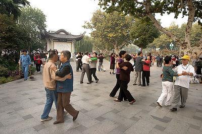 Seniors dancing in the park.
