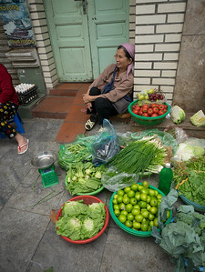 Lady selling veggies and fruits