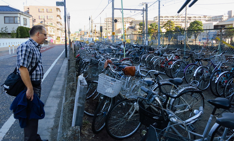 Jim C. admires the bike parking (all commuter style) adjacent to the train track on the way to work.