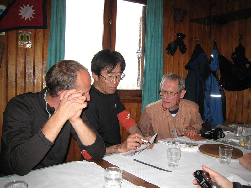 Lutz,Shiro and  Emmo are talking about Trekking route at the Albert Premier Hut.