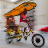 Bicitaxi in motion,  Havana, Cuba, June 11, 2016.