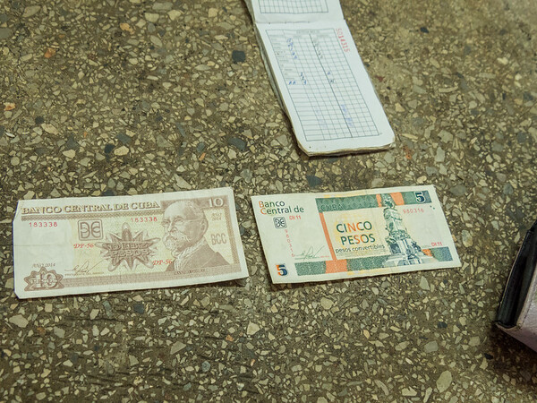 """There are two Cuban currencies, convertible peso (CUC) for tourists and """"diplomats"""", and peso (CUP).  There are 25 CUPs per CUC. Havana, Cuba, June 2, 2016."""