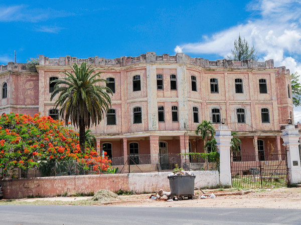 Abandoned pink building, top of the hill at Cojimar, Cuba, June 11, 2016.