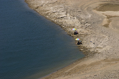 Wayyyyyyy down there, those two dots are people hanging out on the so-called beach. This is not the sort of place I'd choose to go  beaching. But when it's really hot (it is) and you're desperate for a swim--ya take what you can get.