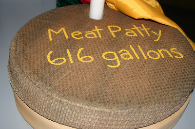 Compare and contrast the water usage of an all-beef patty with non-artery-clogging elements such as lettuces and tomatoes.