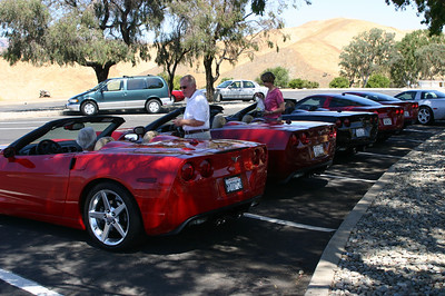 When we arrive, it's an amazing coincidence that these five Corvettes all arrived at this otherwise unvisited spot (Romero Visitor Center at San Luis dam) at the same time and all parked together.  Compare and contrast to our minivan packed with camping gear.