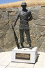 """Against one hill, """"The Airborne Soldier"""" monument stands at rest."""
