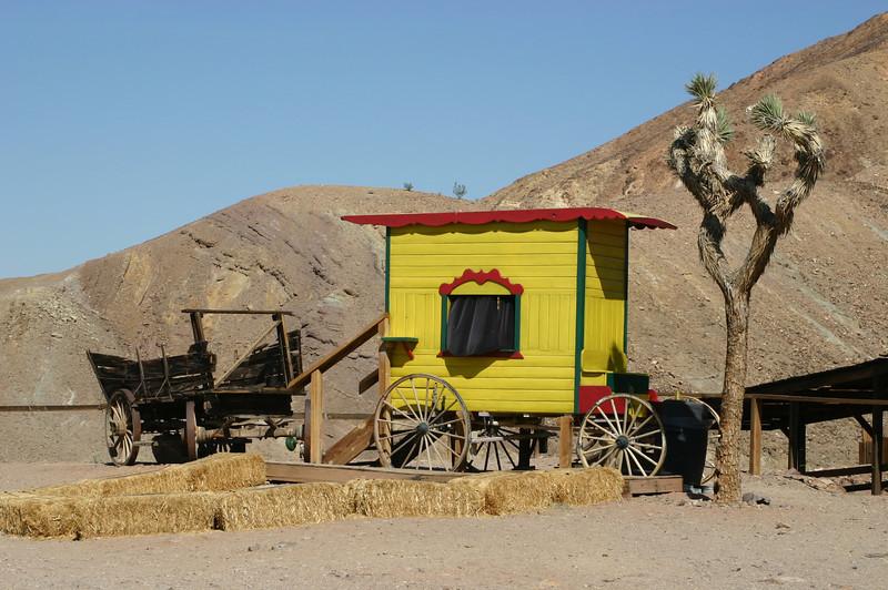 Interesting wagons alongside the main street.