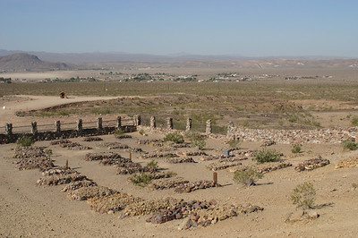 Another view of the many older grave sites and the outskirts of Barstow.
