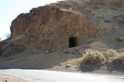 A shallow mineshaft in a hillside.