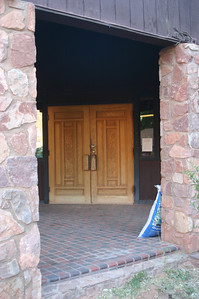 Front doors on the lodge are carved wood.