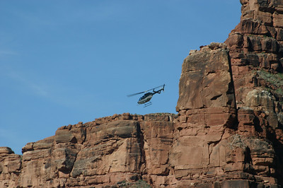 Helicopter near the canyon walls.