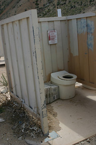 There were regular portapotties that everyone used, but these older composting toilets (with no doors) are still there behind the portapotties.