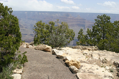The rim trail is paved, but barely wide enough for two people. And the only thing separating you from a long plunge is a low border of rocks. Here, it's not too bad, but in some places--