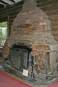 Mary Colter designed this fireplace to show all the layers of rock in the canyon, and its shape reflects the shapes of the appropriate layers, and the stones are actual stones from the corresponding layers. Very cool.