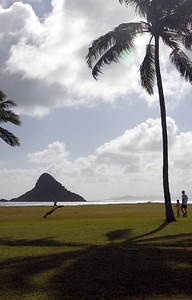 Chinaman's Hat (or Mokolii - little lizard) is located off the shore of Kualoa Park, in Kaneohe Bay, on the island of Oahu.