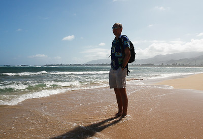 Mr. Reichenberg at Malaekahana Bay State Recreation Area, with Goat Island (Mokuauia) just offshore.