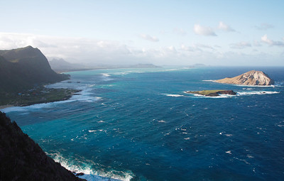 Manana Island (Rabbit Island) and Kaohikaipu Island (Turtle Island, smaller) from Makapuʻu Point, Oahu, Hawaii. Waimanalo and Kailua in the back.