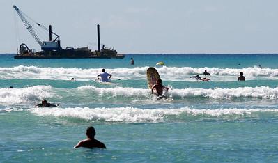 Learning to surf at Waikiki Beach. Thousand dollar views!