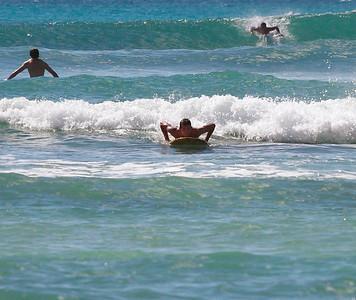 Learning to surf at Waikiki Beach.