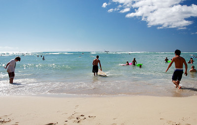 Learning to surf at Waikiki Beach.