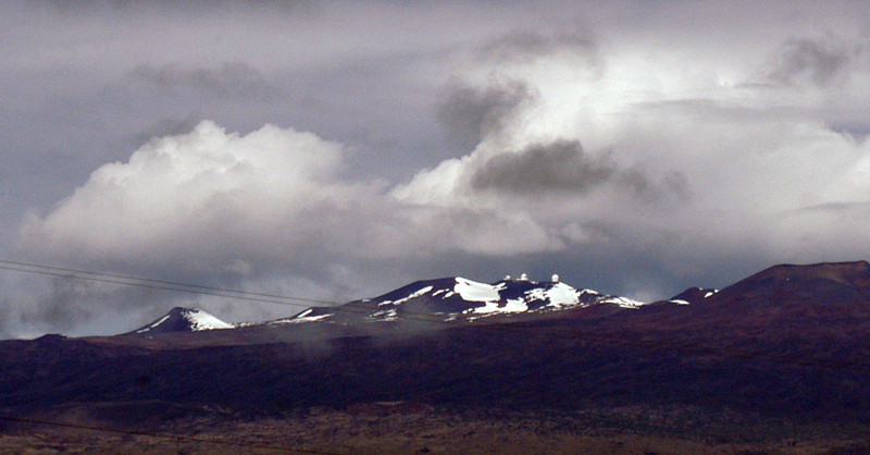 These two photos are of Mauna Kea. Those little bumps are some of the Observatories. See the Mauna Kea pages for closeups.