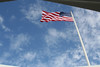 Pearl Harbour - USS Arizona Memorial.  As this flag pole is attached to the original on the ship, the flag still flies over the the Arizona as it did previously.