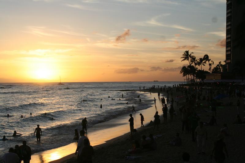 Honolulu - Waikiki Beach at sunset.  Lots of people still enjoying water sports!