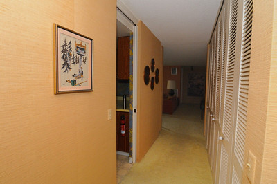 Main corridor past kitchen on left, towards living room