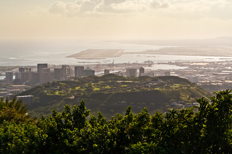 National Memorial Cemetery of the Pacific inside Punchbowl Crater. Honolulu International Airport in the background.