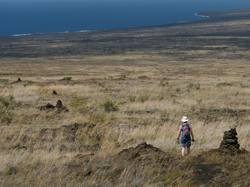 Veronica follows the cairns across the lava field.